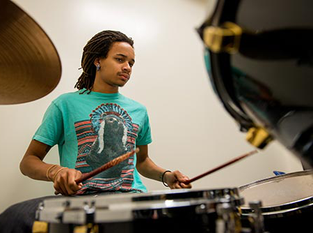 MWSU music major practices on the drums