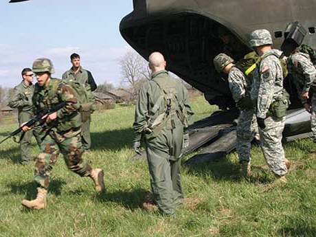 Members of the rotc. exit a cargo plane